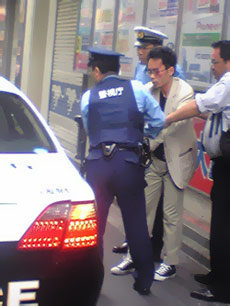 Photo de l'arrestation de Tomohiro Katô